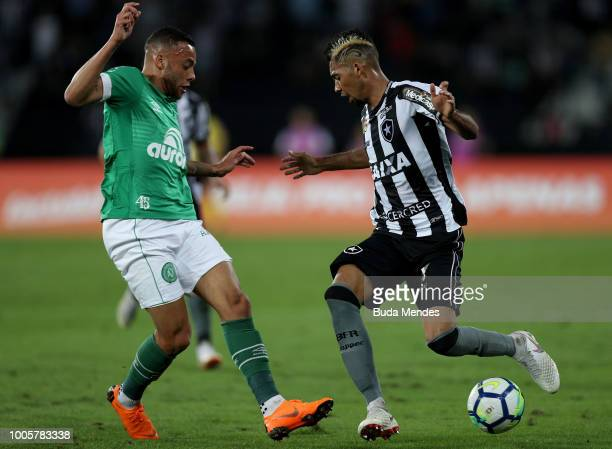 Matheus Fernandes of Botafogo struggles for the ball with Guilherme of Chapecoense during a match between Botafogo and Chapecoense as part of...
