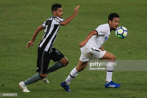 Matheus Fernandes of Botafogo struggles for the ball with Hernane of Sport Recife during a match between Botafogo and Sport Recife as part of...