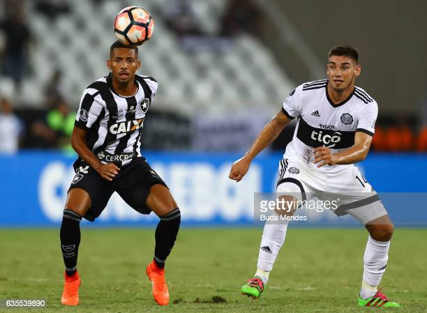 Matheus Fernandes of Botafogo struggles for the ball with Jose Canete of Olimpia during a match between Botafogo and Olimpia as part of Copa...