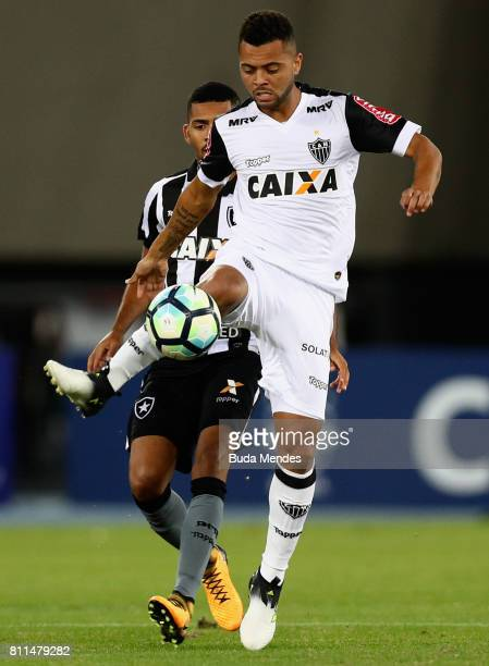 Matheus Fernandes of Botafogo struggles for the ball with Rafael Carioca of Atletico MG during a match between Botafogo and Atletico MG as part of...