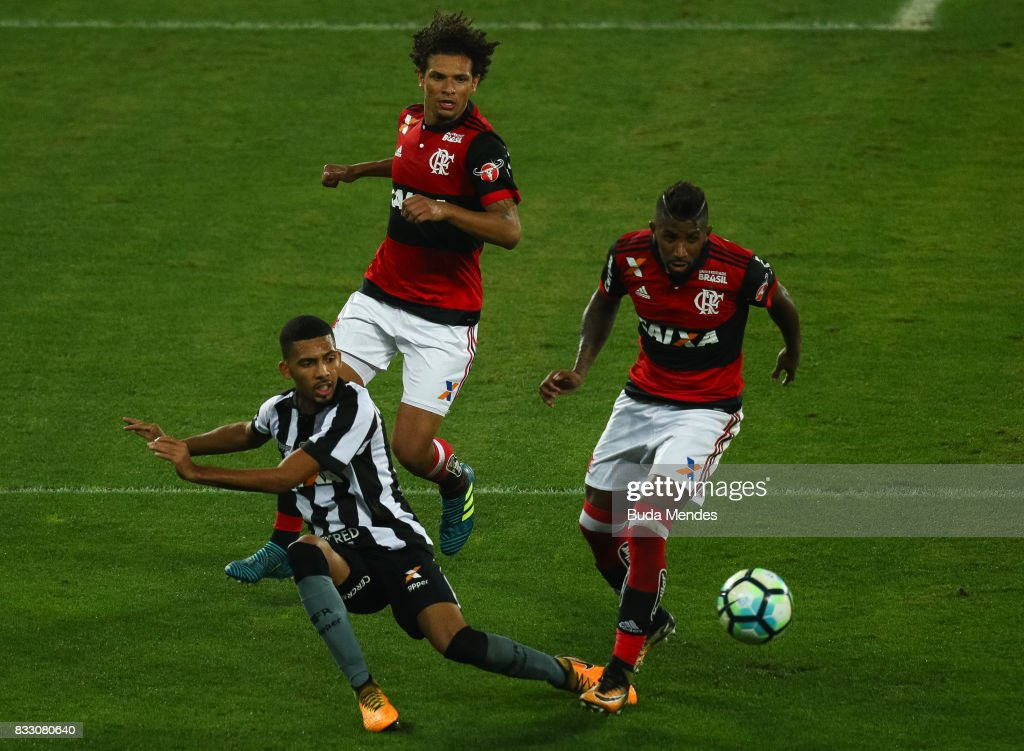 Matheus Fernandes (L) of Botafogo struggles for the ball with Rodinei (R) of Flamengo during a match between Botafogo and Flamengo as part of Copa do Brasil Semifinals 2017 at Nilton Santos Olympic Stadium on August 16, 2017 in Rio de Janeiro, Brazil.