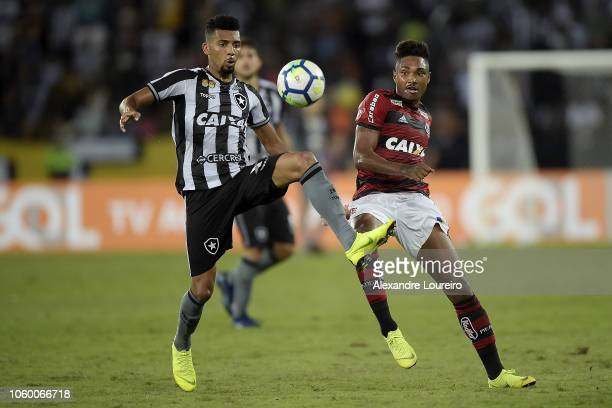 Matheus Fernandes of Botafogo struggles for the ball with Vitinho of Flamengo during the match between Botafogo and Flamengo as part of Brasileirao...