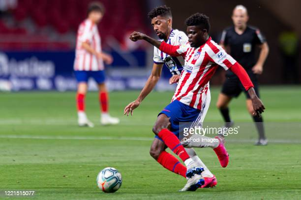 Matheus Fernandes of Real Valladolid CF and Thomas Teye Partey of Atletico de Madrid battle for the ball during the Liga match between Club Atletico...