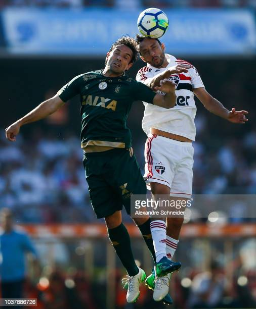 Matheus Ferraz of America MG and Nene of Sao Paulo in action during the match for the Brasileirao 2018 at Morumbi Stadium on September 22 2018 in Sao...