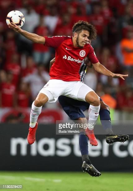 Matheus Galdezani of Internacional struggles for the ball with Cartagena Mendoza of Alianza Lima during a match between Internacional and Alianza...