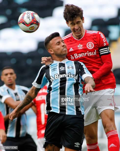 Matheus Henrique of Gremio and Rodrigo Dourado of Internacional fight for the ball during the final of Rio Grande Do Sul State Championship 2021...