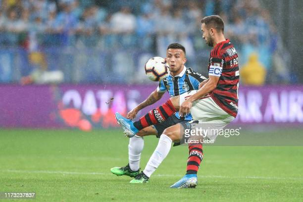 Matheus Henrique of Gremio battles for the ball against Everton Ribeiro of Flamengo during a semi final first leg match between Gremio and Flamengo...