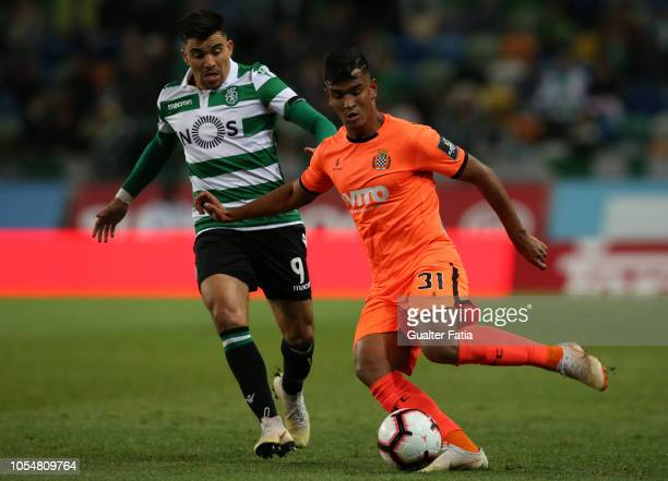 Matheus Indio of Boavista FC with Marcos Acuna of Sporting CP in action during the Liga NOS match between Sporting CP and Boavista FC at Estadio Jose...