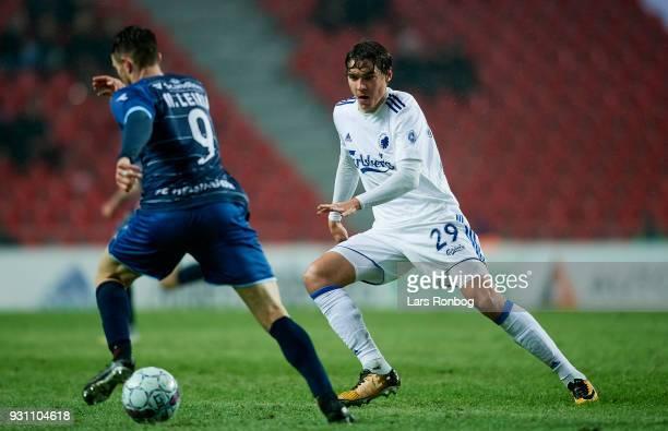Matheus Leiria of FC Helsingor and Robert Skov of FC Copenhagen compete for the ball during the Danish Alka Superliga match between FC Copenhagen and...
