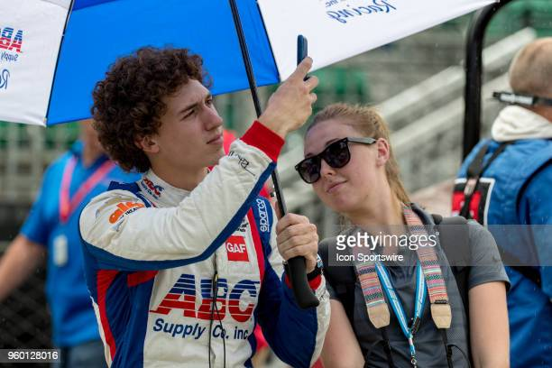 Matheus Leist driver of the AJ Foyt Enterprises Chevrolet takes a photo while delayed for a rain delay during Indianapolis 500 qualifications on May...