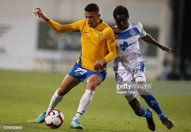 Matheus Luiz of GD Estoril Praia with Andre Bukia of FC Arouca in action during the Ledman Liga Pro match between GD Estoril Praia and FC Arouca at...