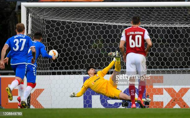 Matheus Magalhaes of Braga saves a penalty from Ianis Hagi of Rangers FC during the UEFA Europa League round of 32 second leg match between Sporting...