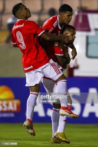 Matheus Monteiro of Internacional celebrates a scored goal with his teammates during a match between Internacional and Corinthians as part of...