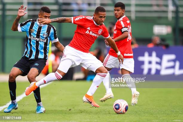 Matheus Monteiro of Internacional struggles for the ball with Diego Rosa of Gremio during a match between Internacional and Gremio as part of Copa...