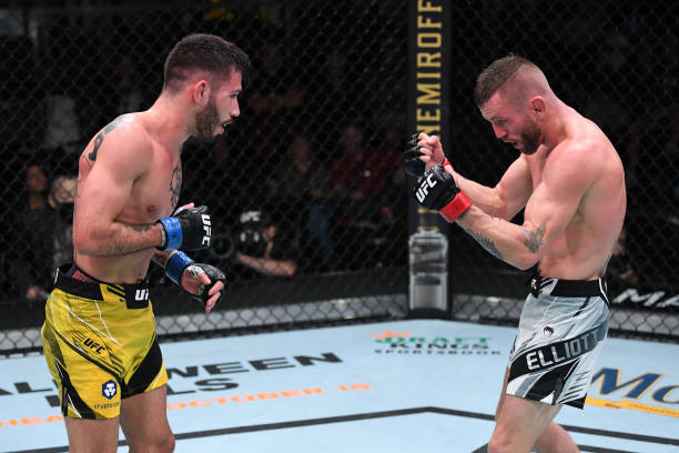 Matheus Nicolau of Brazil and Tim Elliott battle in their flyweight bout during the UFC Fight Night event at UFC APEX on October 09, 2021 in Las...