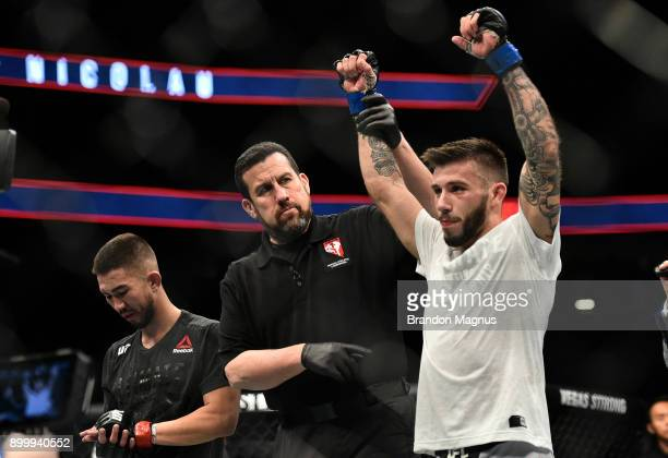 Matheus Nicolau of Brazil celebrates after his unanimousdecision victory over Louis Smolka in their flyweight bout during the UFC 219 event inside...
