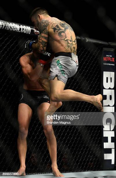 Matheus Nicolau of Brazil lands a flying knee against Louis Smolka in their flyweight bout during the UFC 219 event inside TMobile Arena on December...