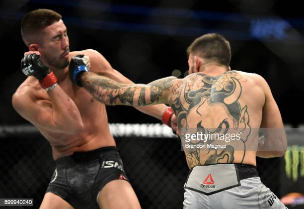 Matheus Nicolau of Brazil punches Louis Smolka in their flyweight bout during the UFC 219 event inside TMobile Arena on December 30 2017 in Las Vegas...