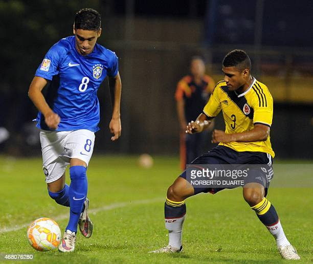 Matheus of Brazil and Jefferson Valdeblanquez of Colombia vie for the ball during their U17 South American final round football match at Feliciano...