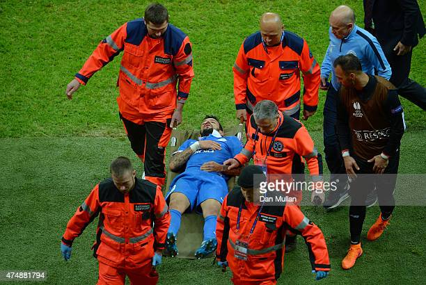 Matheus of Dnipro leaves the field on a stretcher during the UEFA Europa League Final match between FC Dnipro Dnipropetrovsk and FC Sevilla on May...