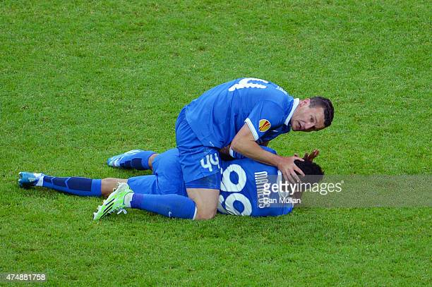 Matheus of Dnipro receives treatment from team mate Artem Fedetskiy during the UEFA Europa League Final match between FC Dnipro Dnipropetrovsk and FC...