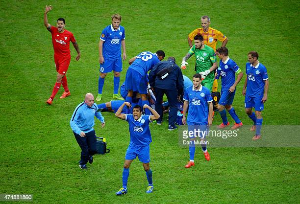 Matheus of Dnipro receives treatment from team mates as players call on medics during the UEFA Europa League Final match between FC Dnipro...