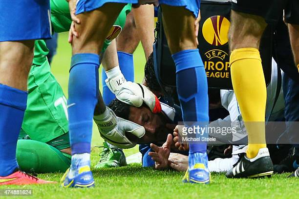 Matheus of Dnipro receives treatment from team mates during the UEFA Europa League Final match between FC Dnipro Dnipropetrovsk and FC Sevilla on May...
