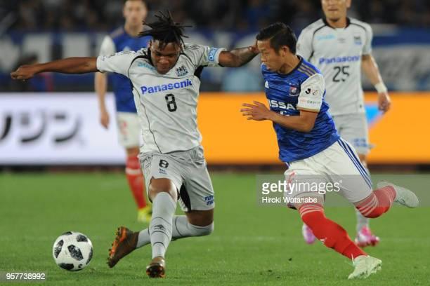 Matheus of Gamba Osaka and Takuya Kida of Yokohama FMarinos compete for the ball during the JLeague J1 match between Yokohama FMarinos and Gamba...