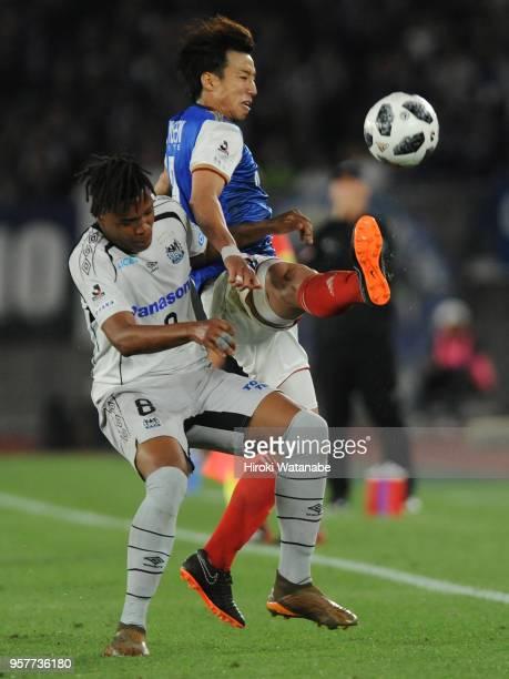 Matheus of Gamba Osaka and Yuki Otsu of Yokohama FMarinos compete for the ball during the JLeague J1 match between Yokohama FMarinos and Gamba Osaka...