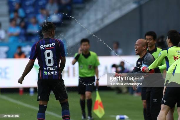 Matheus of Gamba Osaka is congratulated after scoring his side's third goal during the JLeague J1 match between Gamba Osaka and Sagan Tosu at Suita...
