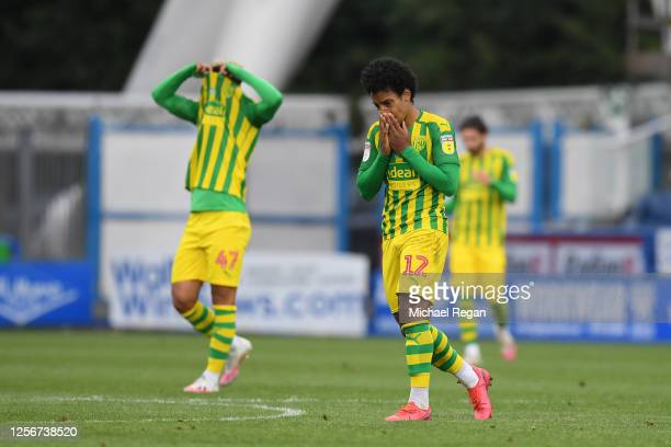 Matheus Pereira and Callum Robinson of West Bromwich Albion look dejected following their sides defeat in during the Sky Bet Championship match...