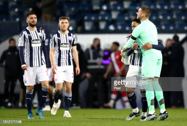 Matheus Pereira and Sam Johnstone of West Bromwich Albion interact following the Premier League match between West Bromwich Albion and Southampton at...