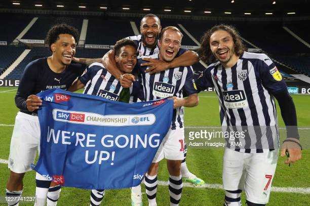 Matheus Pereira Grady Diangana Matt Phillips Kamil Grosicki and Filip Krovinovic of West Bromwich Albion celebrate promotion to the Premier League on...