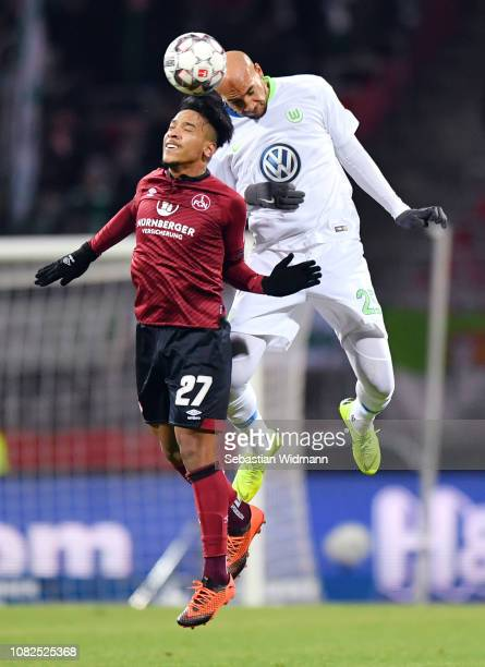 Matheus Pereira of Nuernberg jumps for a header with John Anthony Brooks of Wolfsburg during the Bundesliga match between 1. FC Nuernberg and VfL...