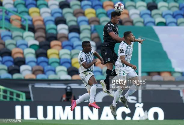 Matheus Pereira of Sporting CP with Leandrinho of Vitoria FC and Eber Bessa of Vitoria FC in action during the Liga NOS match between Sporting CP and...