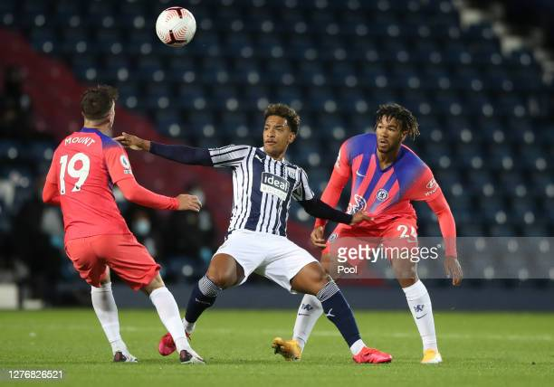 Matheus Pereira of West Bromwich Albion battles for possession with Reece James and Mason Mount of Chelsea during the Premier League match between...