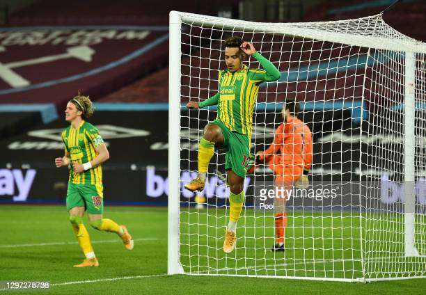 Matheus Pereira of West Bromwich Albion celebrates after scoring their sides first goal during the Premier League match between West Ham United and...