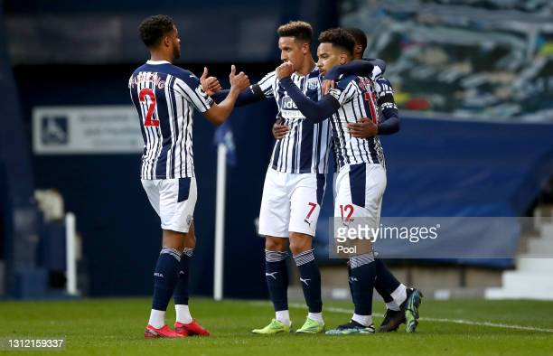 Matheus Pereira of West Bromwich Albion celebrates after scoring their sides first goal with team mates Darnell Furlong, Callum Robinson and Ainsley...