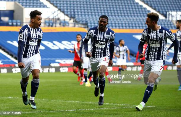 Matheus Pereira of West Bromwich Albion celebrates after scoring their sides first goal with team mates Ainsley Maitland-Niles and Callum Robinson of...