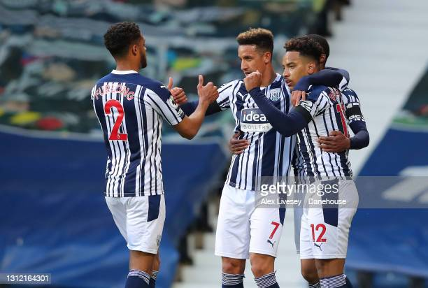 Matheus Pereira of West Bromwich Albion celebrates with team mates after scoring their first goal from the penalty spot during the Premier League...