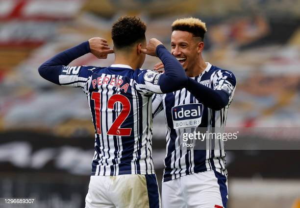 Matheus Pereira of West Bromwich Albion celebrates with teammate Callum Robinson after scoring his team's third goal during the Premier League match...