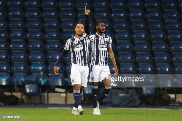 Matheus Pereira of West Bromwich Albion celebrates with team-mate Ainsley Maitland-Niles after scoring their first goal during the Premier League...