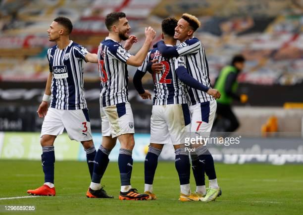 Matheus Pereira of West Bromwich Albion celebrates with teammates Kieran Gibbs, Robert Snodgrass, and Callum Robinson after scoring his team's third...