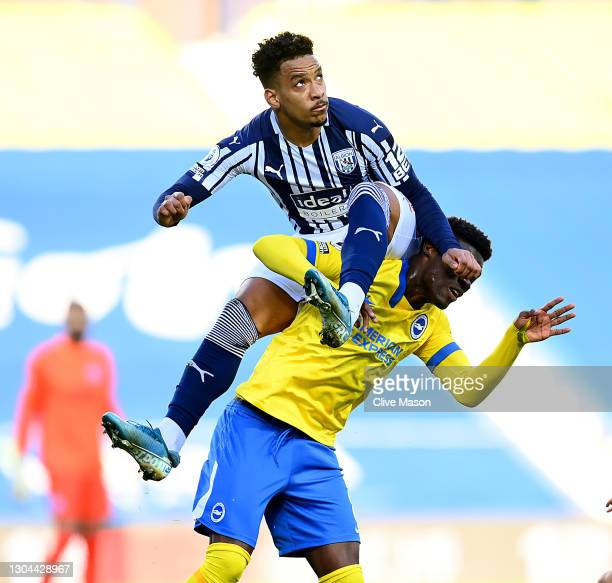 Matheus Pereira of West Bromwich Albion challenges Yves Bissouma of Brighton & Hove Albion during the Premier League match between West Bromwich...