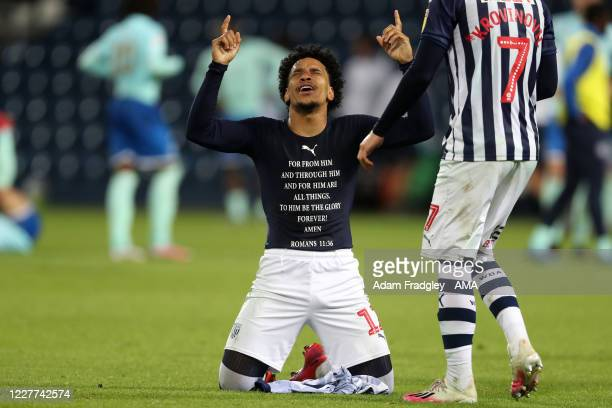 Matheus Pereira of West Bromwich Albion drops to his knees and points to the skies as he celebrates promotion to the Premier League on the pitch at...