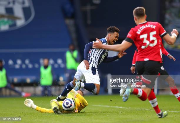 Matheus Pereira of West Bromwich Albion is brought down by Fraser Forster of Southampton for a penalty during the Premier League match between West...