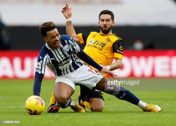 Matheus Pereira of West Bromwich Albion is challenged by Joao Moutinho of Wolverhampton Wanderers during the Premier League match between...
