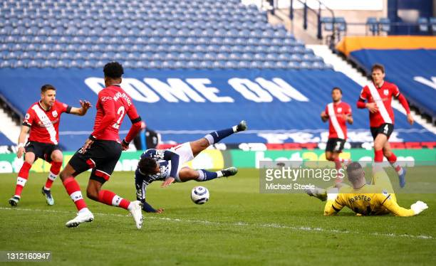 Matheus Pereira of West Bromwich Albion is fouled by Fraser Forster of Southampton resulting in a penalty during the Premier League match between...