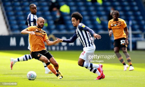 Matheus Pereira of West Bromwich Albion moves away from Kevin Stewart during the Sky Bet Championship match between West Bromwich Albion and Hull...