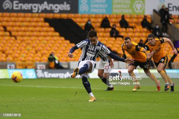 Matheus Pereira of West Bromwich Albion scores a goal to make it 0-1 from the penalty spot during the Premier League match between Wolverhampton...